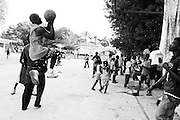 When they're not searching for food or water, boys of all ages at the St. Louis tent city in Port-au-Prince congregate to play soccer and basketball.