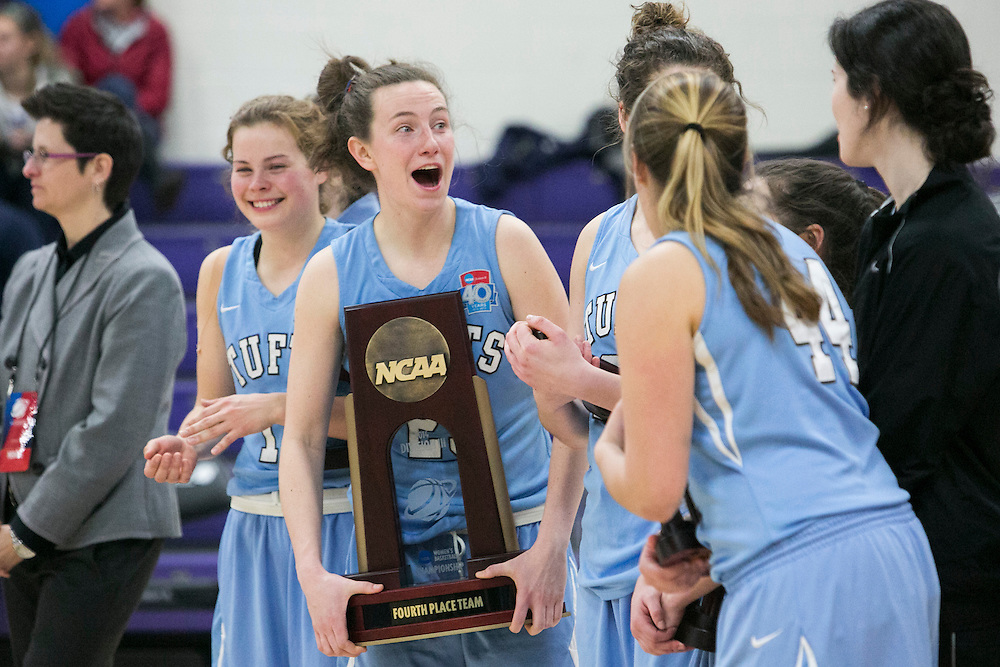 03/22/2014- Stevens Point, Wisc. - Tufts guard Liz Moynihan, A14, jokes around with teammates with the NCAA fourth-place trophy after their 72-54 loss to Wisconsin-Whitewater in the NCAA Division III Women's Final Four consolation game at Quandt Fieldhouse on Mar. 22, 2014. (Kelvin Ma/Tufts University)