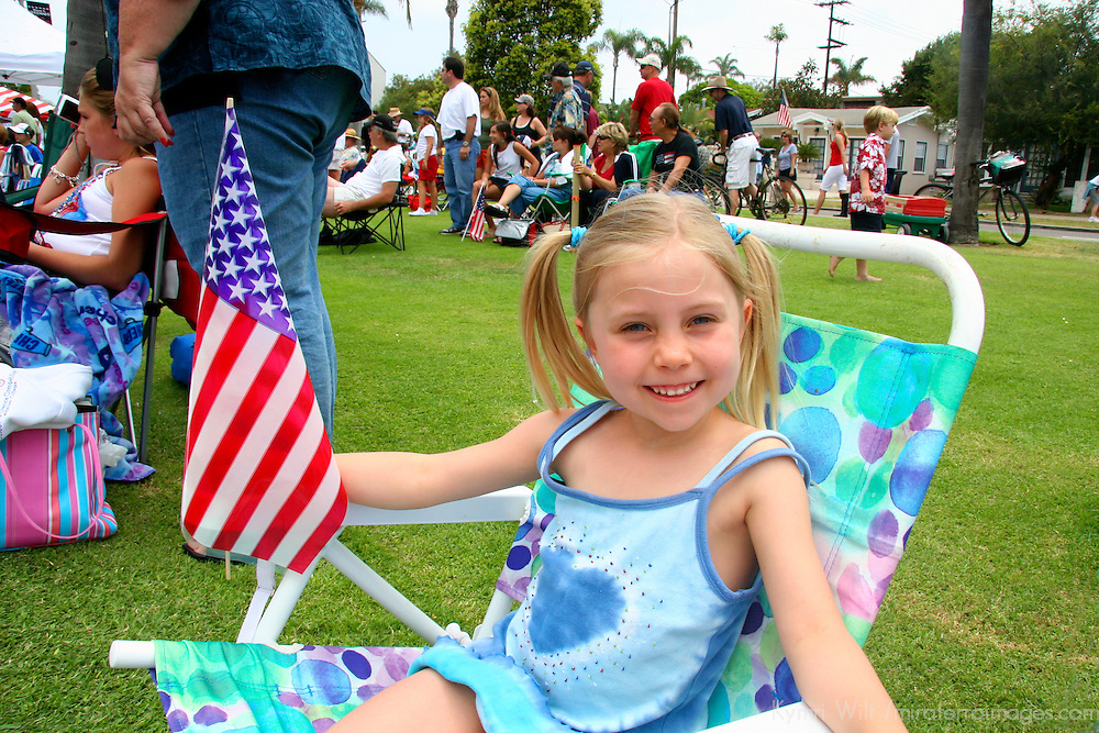 USA, United States, America. A young girl shows patriotism at a 4th of July parade in Coronado, California.