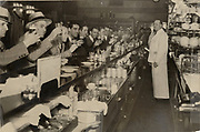 On April 7,1933, patrons of Frank Rippe's Cafe raise a toast when beer becomes legal for the first time since dry laws took effect. (The Seattle Times)