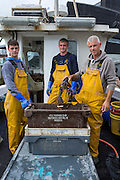 Peter Reed Jnr, Arun &amp; Zack<br /> <br /> Rowena - FE75<br /> <br /> 4th Generation Fishermen<br /> <br /> Main Activity: Potting &amp; Netting<br /> <br /> Folkestone was founded on its fishing industry which dates back to pre-Roman times.  During its heyday there were over 100 boats operating out of the busy harbour and employing over 1000 people in the town.  However today, there are only 8 working boats left, employing just over 20 people. The boats are owned and managed by Folkestone families who have a strong fishing heritage. Photographer Andrew Aitchison, has been working with Folkestone Trawlers to capture portraits of the active fishermen in the summer of 2016.