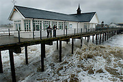 Southwold Pier, Southwold, Suffolk, Britain. Rain and heavy seas on Spring Bank Holiday Monday, 2008..COPYRIGHT PHOTOGRAPH BY BRIAN HARRIS  © 2008.07808-579804