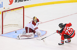 Mar 27, 2014; Newark, NJ, USA; Phoenix Coyotes goalie Thomas Greiss (1) makes a save on New Jersey Devils left wing Ryane Clowe (29) during the shootout at Prudential Center. The Coyotes defeated the Devils 3-2 in a shootout.