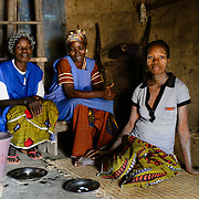 Traditional birth attendant, Antoinette Die Monti (centre), with a colleague and expecting mother in a room in her home where she used to deliver babies before the establishment of a village health centre, and also during the years of Cote d'Ivoire's civil war when the health centre was closed down.