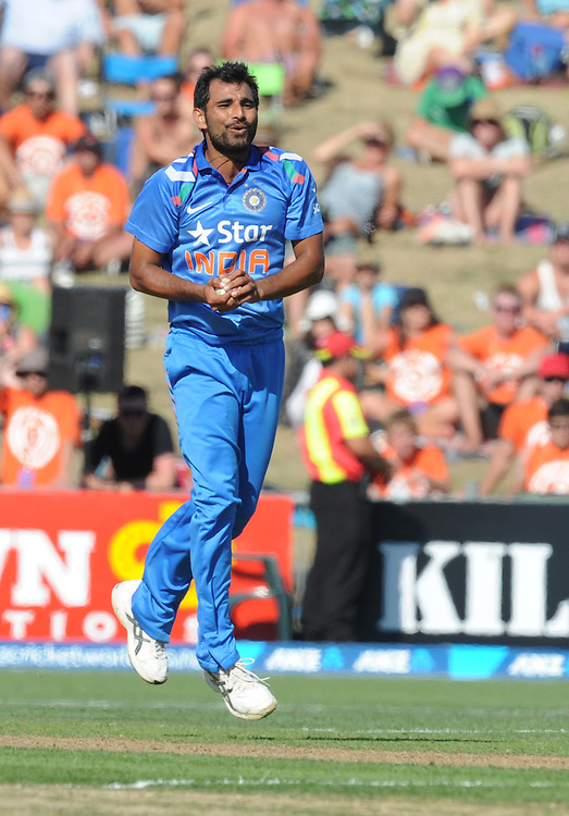 India's Mohammed Shami takes a caught and bowled to dismiss Nathan McCullum in the first one day International cricket match, McLean Park, New Zealand, Sunday, January 19, 2014. Credit:SNPA / Ross Setford