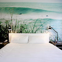 ST. PETE BEACH, FL -- February 13, 2010 -- A surf-inspired guest room is seen at the Postcard Inn in St. Pete Beach, Fla., on Saturday, February 13, 2010.  The beachfront U-shaped hotel, originally built in 1957, was renovated into a throwback surf shack of sorts with rooms featuring surfing imagery and vintage furniture. (Chip Litherland for The New York Times)