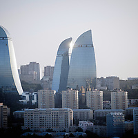 Baku, Azerbaijan, 26 July 2012<br /> View of the Flames towers.<br /> Baku is the capital and largest city of Azerbaijan, as well as the largest city on the Caspian Sea and of the Caucasus region. It is located on the southern shore of the Absheron Peninsula, which projects into the Caspian Sea. <br /> The city consists of two principal parts: the downtown and the old Inner City (21.5 ha). <br /> Baku's urban population at the beginning of 2009 was estimated at just over two million people. Officially, about 25 percent of all inhabitants of the country live in the metropolitan city area of Baku.<br /> Photo: Ezequiel Scagnetti