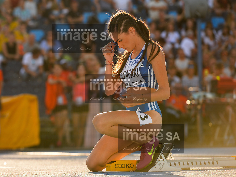 BYDGOSZCZ, POLAND - JULY 21: Dimitra Gnafaki of Greece in the semi final of the women's 400m hurdles during the evening session on day 3 of the IAAF World Junior Championships at Zawisza Stadium on July 21, 2016 in Bydgoszcz, Poland. (Photo by Roger Sedres/Gallo Images)