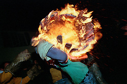 """FLAMING BARREL ON BACK""..TAR BARRELS OF OTTERY ST MARY EAST DEVON..BY RUPERT RIVETT.07771928201.(01273)695107"
