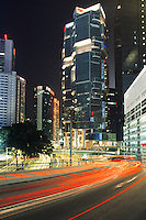 Traffic and skyscrapers at night in Kowloon, Hong Kong, China.