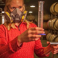 Production Manager Charlotte Good adds a solution of Sulfur Dioxide to grape juice and wine to prevent oxidation and microbial spoilage at different stages of the aging process at Hunnicutt's Winery, Saint Helena, CA