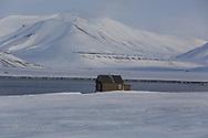 Coastal hut in April between Longyearbyen and Barentsburg; Svalbard, Norway.