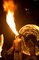 A tribal man breathes fire during a performance at the entrance to the Singapore Night Safari zoo for nocturnal animals.