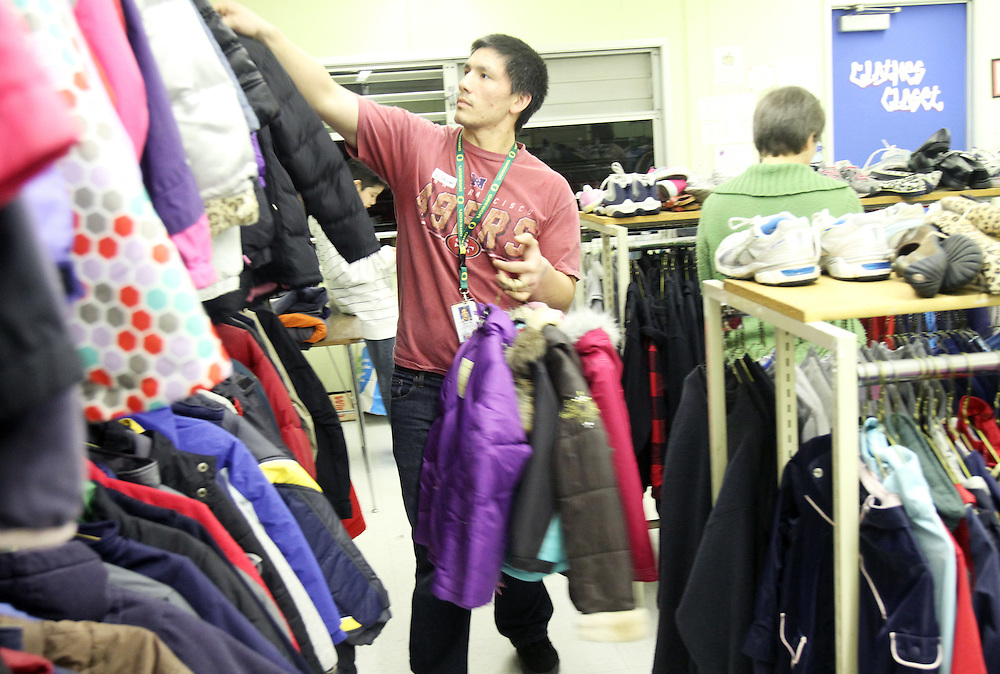 Aaron Boje arranges clothes. The Beaverton School District has a Clothes Closet for students in need. Photographed Wednesday, Jan. 25, 2011.