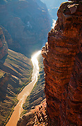 Sunlight reflects off the Colorado River 3,000 feet below the viewpoint at Toroweap. Grand Canyon National Park.