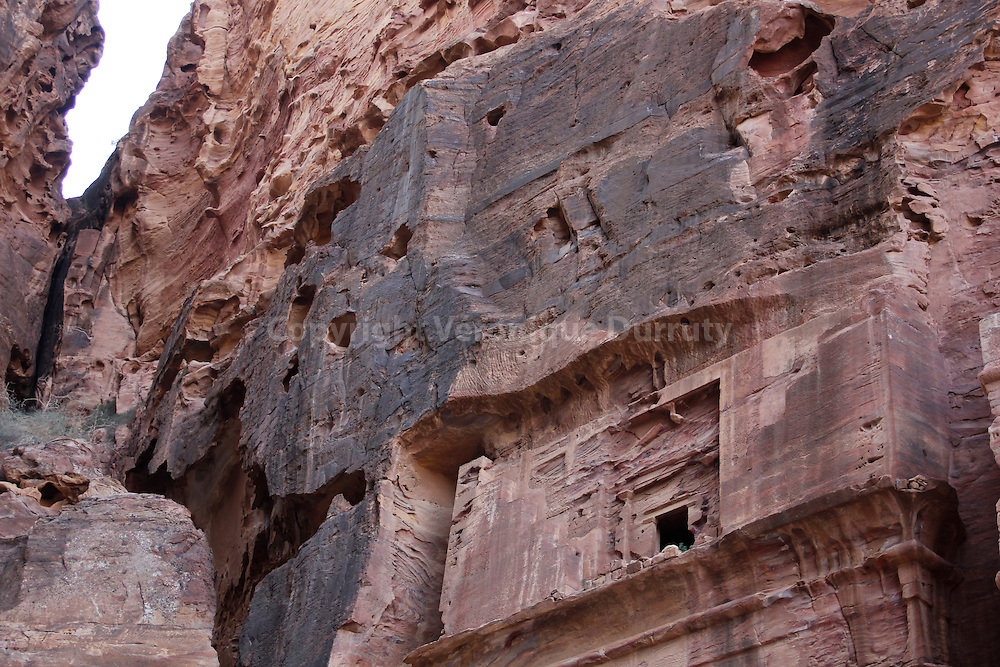 Petra is a historical and archaeological city in the Jordanian governorate of Ma'an that is famous for its rock cut architecture and water conduits system. Established sometime around the 6th century BC as the capital city of the Nabataeans, it is a symbol of Jordan as well as its most visited tourist attraction. It lies on the slope of Mount Hor in a basin among the mountains which form the eastern flank of Arabah (Wadi Araba), the large valley running from the Dead Sea to the Gulf of Aqaba. Petra has been a UNESCO World Heritage Site since 1985..The site remained unknown to the Western world until 1812, when it was introduced by Swiss explorer Johann Ludwig Burckhardt.