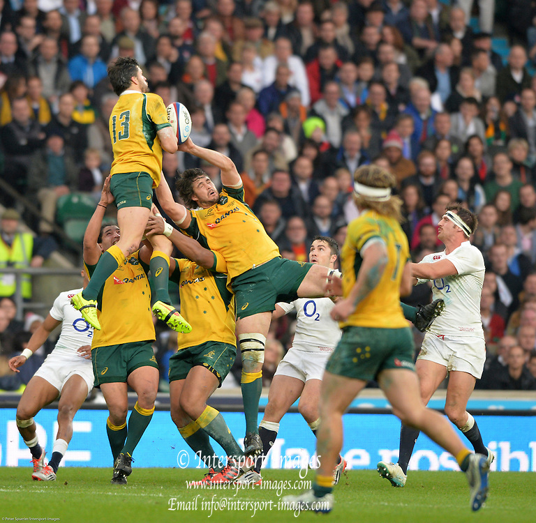Twickenham, Great Britain,  Australia, go for the high ball ariel, Adam ASHLEY-COOPER, then left to right Saia FAINGA'A Sekope KEPU and Sam CARTER collectively gather the ball during the QBE Autumn International, England vs Australia, played at the RFU Stadium, Twickenham, ENGLAND. 15:36:59   Saturday  29/11/2014  [Mandatory Credit; Peter Spurrier/Intersport-images]