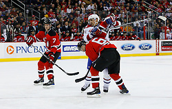 Jan 2, 2009; Newark, NJ, USA; New Jersey Devils defenseman Andy Greene (6) takes an interference penalty on Montreal Canadiens center Tomas Plekanec (14) during the first period at the Prudential Center.