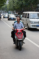 two men on moped in Shanghai China