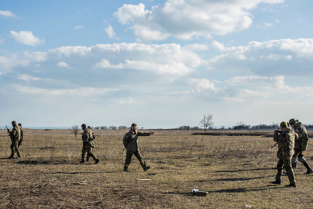 Alex, center, a drill sergeant, instructs members of the Azov Brigade during weapons training at one of the group's training grounds on Saturday, March 7, 2015 in Kulykivske, Ukraine. Photo by Brendan Hoffman, Freelance