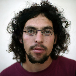 """Nathan Hymanat, 18, a military school student who was born in the Gush Katif settlements, is seen in  Gaza, Palestinian Territories, Nov. 4, 2004. When asked his thoughts about leaving the settlements and about the risk to Israeli soldiers, Hymanat responded, """"We are part of Israel and a strategic point. If we move, they are going to bomb Ashkelon."""" Adding, """"I am very sad when soldiers are injured here, but I will also protect Israel with my life."""" Israel's parliament recently supported compensation payments for Jewish settlers leaving the Gaza Strip, in a vital vote for Prime Minister Ariel Sharon's plan to evacuate the occupied territory."""
