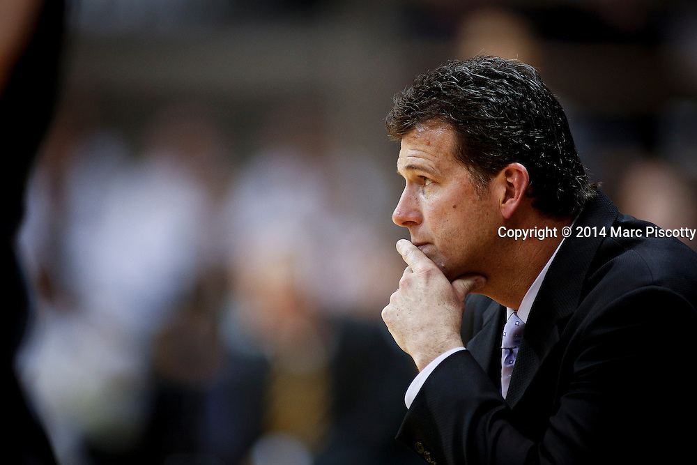 SHOT 1/16/14 8:03:00 PM - UCLA head basketball coach Steve Alford watches his team play against Colorado during their regular season Pac-12 Conference basketball game at the Coors Events Center in Boulder, Co. UCLA won the game 69-56.<br /> (Photo by Marc Piscotty / &copy; 2014)