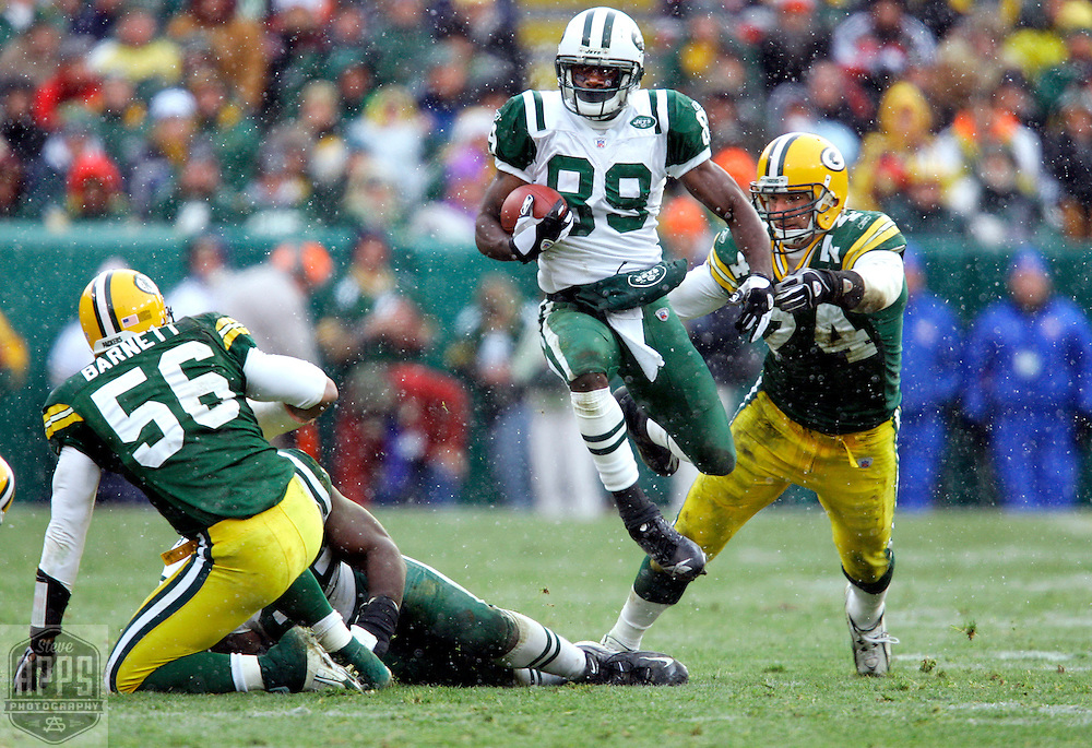 New York's Jerricho Cotchery run for 5-yards on a Chad Pennington pass on 3rd and 4-yards in the 2nd quarter. &amp;#xA;The Green Bay Packers hosted the New New Jets at Lambeau Field Sunday December 3, 2006. Steve Apps-State Journal.<br />