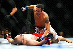 August 9, 2008; Minneapolis, MN, USA;  Lightweights Robert Emerson (white trunks) and Manvel Gamburyan (red trunks) battle during their bout at the Target Center in Minneapolis, MN at UFC 87: Seek and Destroy.  Emerson won via 1st round TKO on strikes.