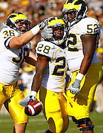 WEST LAFAYETTE, IN - OCTOBER 06: Defensive back AJ Pearson #36 of the Michigan Wolverines, running back Fitzgerald Toussaint #28 of the Michigan Wolverines and offensive linesman Ricky Barnum #52 of the Michigan Wolverines celebrate a touchdown against the Purdue Boilermakers at Ross-Ade Stadium on October 6, 2012 in West Lafayette, Indiana. (Photo by Michael Hickey/Getty Images) *** Local Caption *** AJ Pearson; Fitzgerald Toussaint; Ricky Barnum