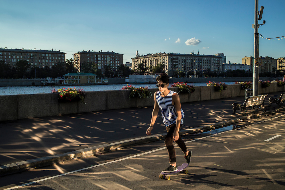 A man skateboards along the Moscow River in Gorky Park on Saturday, August 17, 2013 in Moscow, Russia.
