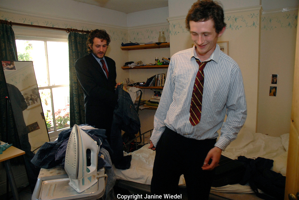University students getting dressed for formal occassion in student lodgings.