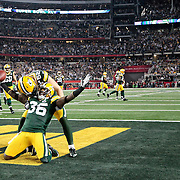 Green Bay Packers' Nick Collins celebrates his interception that he returned for a touchdown in the 1st quarter..The Green Bay Packers played the Pittsburgh Steelers in Super Bowl XLV,  Sunday February 6, 2011 in Cowboys Stadium. Steve Apps-State Journal.
