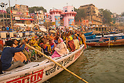 Hindu families rowing down the Ganges, Varanassi, India