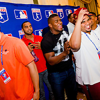 Yasiel Puig, left, and Brayan Pena share a laugh after a presser at the Hotel Nacional de Cuba as MLB players make a goodwill trip to Havana, Cuba. (Photo by Chip Litherland/The Players' Tribune)