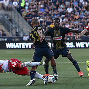 New York Red Bulls Attacker ANATOLE ABANG (9) goes for the ball as Philadelphia Union Defender FABIO ALVES (33) dribbles up the field in the first half of a Major League Soccer match between the Philadelphia Union and New York Red Bulls Sunday, July. 17, 2016 at Talen Energy Stadium in Chester, PA.