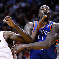 16 March 2011: Oklahoma City Thunder center Kendrick Perkins (5) vies for the rebound with Miami Heat center Joel Anthony (50) during the Oklahoma City Thunder 96-85 victory over the Miami Heat at the AmericanAirlines Arena, Miami, Florida, USA.