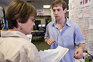 Mary Coiner, left, a volunteer with Organizing for America, President Obama's re-election campaign arm, talks with intern Jake Selby in the group's Richmond headquarters on Thursday, May 3, 2012 in Richmond, VA.