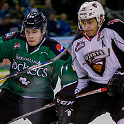 KELOWNA, CANADA - MARCH 17:  Kyle Topping #24 of the Kelowna Rockets, Calvin Spencer #22 of the Vancouver Giants at the Kelowna Rockets game on March 17, 2017 at Prospera Place in Kelowna, British Columbia, Canada.  (Photo By Cindy Rogers/Nyasa Photography,  *** Local Caption ***