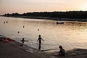 Travel in Croatia<br /> <br /> Children playing in the water on Rab Island.<br /> <br /> June 2013<br /> Matt Lutton