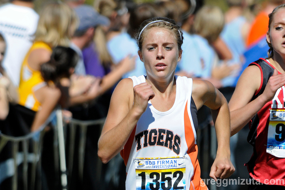 Mountain Home senior Jordan Vivier comes down the finish line straightaway during the Bob Firman Invitational D1 Girl's race at Eagle Island State Park on September 25, 2010. Vivier was Mountain Home's top runner and finished twenty-seventh overall with a time of 20:45.65.