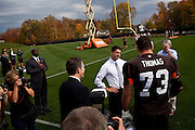 Republican vice presidential candidate Rep. Paul Ryan, center, talks with Cleveland Browns player Joe Thomas, right, on the Cleveland Browns practice field in Berea, Ohio, October 17, 2012.