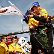 Romain Dumas, left and Timo Bernhard hug as they stand on the P2 Porsche RS Spyder in the pit area and celebrate their win in the Round 4 American Le Mans Series at the Larry H. Miller Dealerships Utah Grand Prix at Miller Motor Sports Park in Tooele, Utah Sunday May 18, 2008. August MIller/ Deseret News .