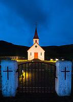 Warm glow on a church at twilight in Reynisdrangar, near Vik, Iceland