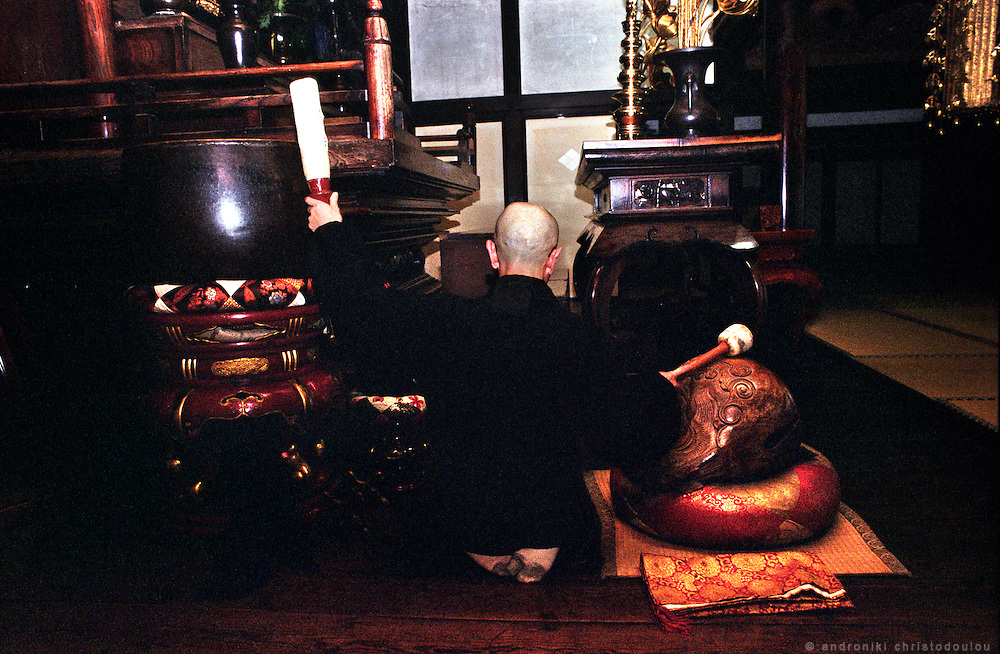 LIVING ZEN - HOSHINJI MONASTERY, OBAMA-JAPAN..Monk practicing on the bells to be ready to play as part of a ceremony.