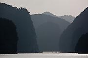 Misty silhouette of limestone karsts and islands in Ha Long Bay, near Cat Ba Island, Vietnam