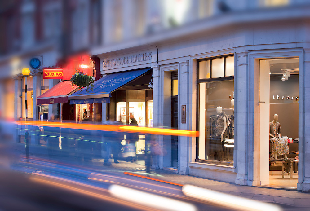 london shops at dusk on marylebone high street with car light trails