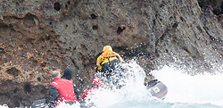 Nick Hancock (yellow) leaps to get on Rockall, for his reconnaissance mission for a future 60 day occupation of Rockall. The Rockall Jubilee Expedition, a unique endurance expedition to be undertaken by Nick, in order to raise funds for Help for Heroes .©Michael Schofield..