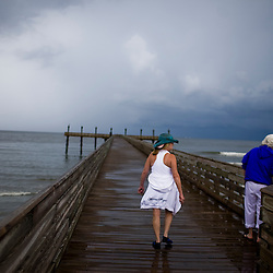 From left, Yvonne Baker and Donna Ferguson of Maurepas, LA look on into the Gulf on June 23, 2010 in Grand Isle State Park, LA where oil has reached the shore. Ferguson and Baker own a seafood restaurant and came to Grand Isle to see what the Gulf looked like since the spill.