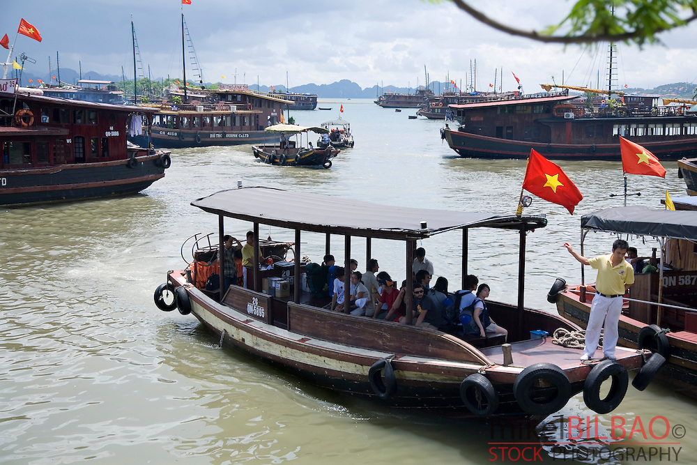 Junks tourism boats in Halong city. Ha Long Bay. <br /> Quang Ninh province, Vietnam.