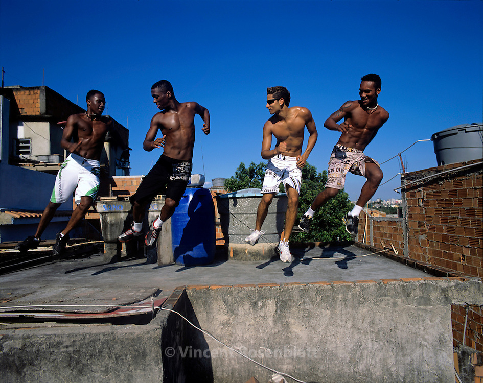 """Vitor Hugo, Diego, Anderson and Heverton, """"Muleks 100 limits"""" (""""boys without limits"""") are training on the rooftop of Diego's house, on the heights of  Mangueira slum. They train almost every day, and perfect their choreographies, hoping to have success on the carioca funk scene and get a better life. Mangueira, Rio de Janeiro.."""